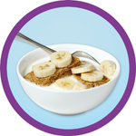 A bowl of wheet bix with milk and sliced banana